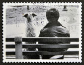 UNITED KINGDOM - CIRCA 2001: A stamp printed in Great Britain shows Dog and Owner on Bench, circa 2001 — Stock Photo