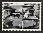 UNITED KINGDOM - CIRCA 2001: A stamp printed in Great Britain shows Dog in car, circa 2001 — Stock Photo