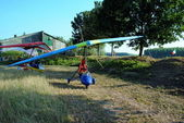 Colorful hang glider ready to take off — Stock Photo