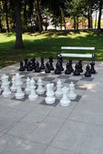 Big chess set in the park with benches — Stock Photo