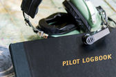 Logbook and headset — Stock Photo