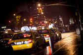New York cabs in a rainy night — Stock Photo