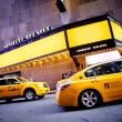 Stock Photo: Theatre and yellow cabs with copyspace