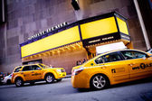 Theatre and yellow cabs with copyspace — Stock Photo