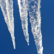 Icicles on a background of the blue sky — Stock Photo