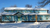 Long rural church in winter — Stock Photo