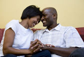 Happy couple on couch — Stock Photo