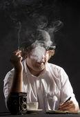 Smoking journalist — Stock Photo