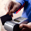 African hand swiping credit card — Stock Photo
