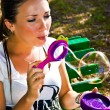 The girl blowing soap bubbles — Stock Photo