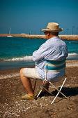 Elderly man ashore — Stock Photo