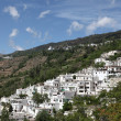 White Andalusian village Pampaneira in Spain - Stock Photo