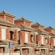 Row of almost finished residential buildings - Stock Photo