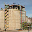 Storage tank in an oil refinery - Stock Photo