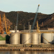 Fuel storage tanks at the industrial port - Stock Photo