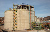 Storage tank in an oil refinery — Stock Photo