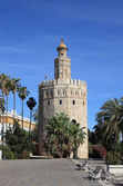 "The Torre del Oro (English: ""Gold Tower"") in Seville, Spain — Stock fotografie"