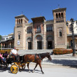 Horse drawn carriage in front of the Museum of Arts and Traditions in Seville, Andalusia Spain - Stock Photo