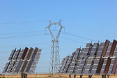 Solar power station with power pole — Stock Photo