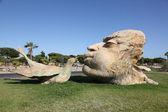 Man kissing a bird - sculpture in Matalascanas, Andalusia Spain — Stock Photo