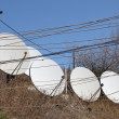 Stock Photo: Satellite dishes and cables
