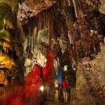 Illuminated stalactites inside of the St. Michaels Cave of Gibraltar — Stock Photo #12350508