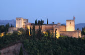 Ramparts of the Alhambra illuminated at dusk. Granada, Andalusia Spain — Stock Photo