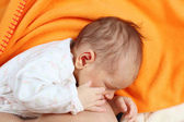 Mother breastfeeding her newborn baby girl — Stock Photo