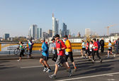 Runners on the bridge over the Main River during the Frankfurt Marathon 2010 in Germany — Stock Photo