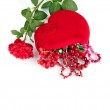 Red heart-shaped casket with beads of semi-precious stones and — Stock Photo