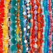Lot of colored beads from different minerals and stone backgroun — Stock Photo #11379898