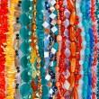Stock Photo: Lot of colored beads from different minerals and stone backgroun