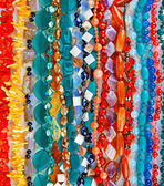 Lot of colored beads from different minerals and stone backgroun — Foto de Stock
