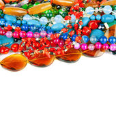 Natural colorful stones beads from different minerals isolated o — Stock Photo
