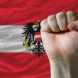 Hard fist in front of austria flag symbolizing power — Stock Photo