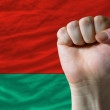 Hard fist in front of belarus flag symbolizing power — Stock Photo