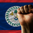 Hard fist in front of belize flag symbolizing power — Stock Photo