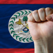 Hard fist in front of belize flag symbolizing power — Foto Stock