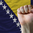 Stock Photo: Hard fist in front of bosniherzegovinflag symbolizing power