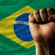 Hard fist in front of brazil flag symbolizing power — 图库照片