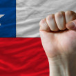 Hard fist in front of chile flag symbolizing power — Foto de Stock