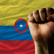 Hard fist in front of colombia flag symbolizing power — Foto Stock