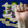 Us state flag of connecticut with hard fist in front of it symbo — Stock Photo