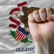 Us state flag of illinois with hard fist in front of it symboliz — Stock Photo