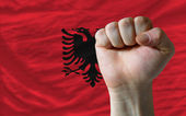 Hard fist in front of albania flag symbolizing power — Stock Photo
