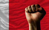 Hard fist in front of bahrain flag symbolizing power — Stock Photo
