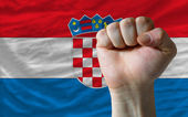Hard fist in front of croatia flag symbolizing power — Stock Photo