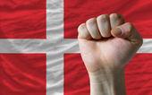 Hard fist in front of denmark flag symbolizing power — Stock Photo