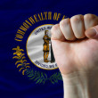 Us state flag of kentucky with hard fist in front of it symboliz — Stock Photo