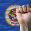 Us state flag of minnesota with hard fist in front of it symboli — Stock Photo